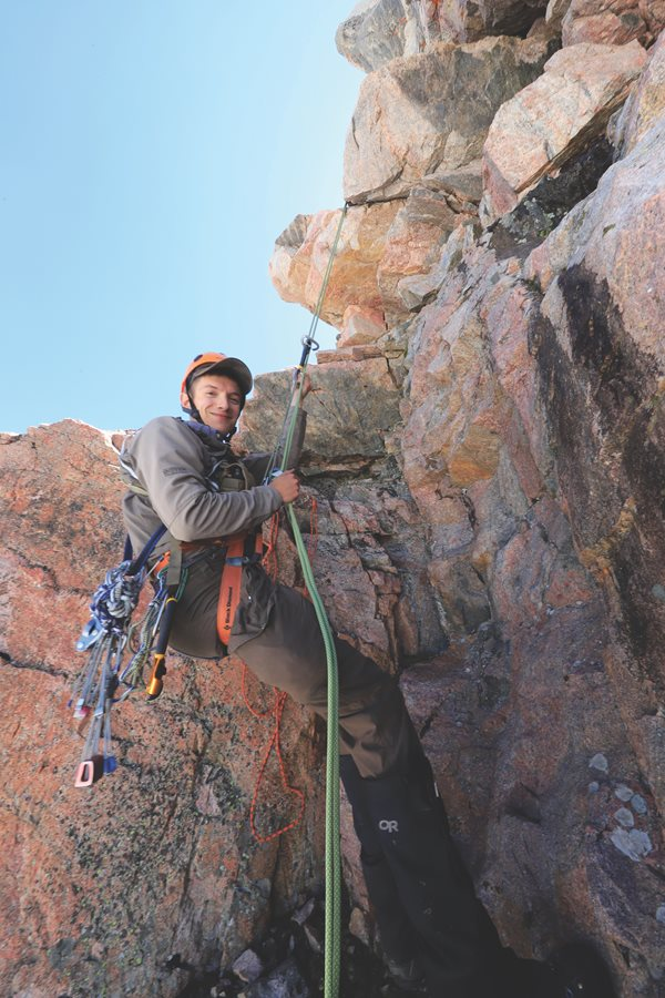 Carl Brown is no stranger to mountaineering, and his experience has proven invaluable throughout his study. Gaining access to black rosy finch nests requires skills in hiking, climbing and rappelling. Photo by Mark Gocke